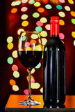 Still life, Red wine with glass and bokeh background, lowkey Royalty Free Stock Image