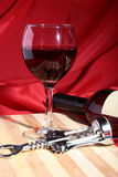 Still life with red wine grapes and chees on wooden table. Stock Photos