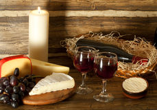 Still-life with red wine , grapes and cheese Royalty Free Stock Photo