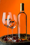 Still life with red wine and heart Stock Images