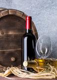 Still life with red wine and heart. On a barrel Stock Photos
