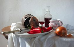 Still life with red wine and red peppers Royalty Free Stock Photo