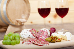 Still life with red wine and wooden cask. Royalty Free Stock Photo