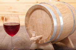 Still life with red wine and wooden cask. Stock Images