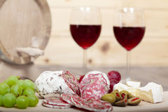 Still life with red wine and wooden cask. Royalty Free Stock Photos