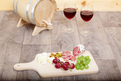 Still life with red wine and wooden cask. Stock Photos