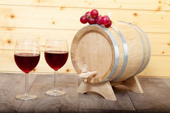 Still life with red wine and wooden cask. Royalty Free Stock Photography