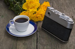 Still life on a retro, the camera, roses and coffee Royalty Free Stock Photo