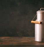 Still life with retro metal milk can Royalty Free Stock Photo