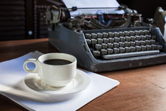 Still life of retro office. Telephone, type writer and flower in silver vase place near old lamp on wooden table Royalty Free Stock Images