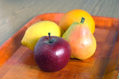 Still life with ripe fruits on brown tray close-up Royalty Free Stock Photos