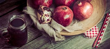 Still life with ripe garnets. On a wooden background Royalty Free Stock Photography
