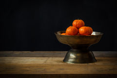 Still life with Ripe orange placed in tray Stock Images