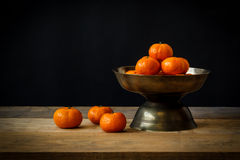 Still life with Ripe orange placed in tray Stock Photography