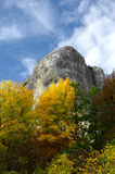 Still life with rock, colored trees and blue sky. In mountains of Crimea Royalty Free Stock Photography