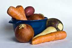 Root vegetables. A closeup of root vegetables and a casserloe bowl Stock Photo