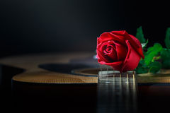 Still life rose and guitar Royalty Free Stock Image