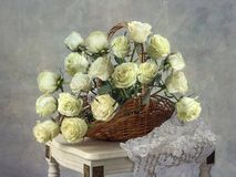 Still life with roses basket. Still life whith bouquet flowers Stock Images
