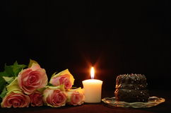Still life. With roses candle and cake royalty free stock photo