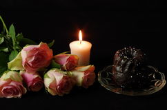 Still life. With roses candle and cake royalty free stock image