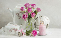 Still life with roses and dishes Royalty Free Stock Images