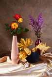 Still-life with roses and dry maple leaves Royalty Free Stock Photos