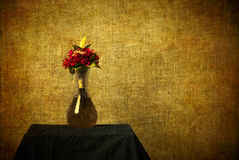 Still Life of Roses in Vase with Texture Added. A still-life image of red roses in a vase with texture added in a grunge style and including ample copy space stock image
