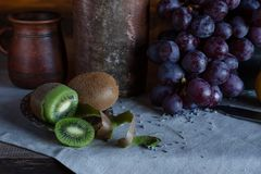 Still life in a rustic style. ceramic dishes and  fruits stock photos