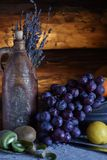 Still life in a rustic style. ceramic dishes and  fruits stock photography