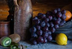 Still life in a rustic style. ceramic dishes and  fruits stock photo
