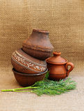 Still life in a rustic style with pottery and herbs. Stock Photos