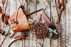 Still-life of rusty metal items on wooden background. Royalty Free Stock Photo