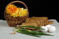 Still life with rye bread, green onions and eggs Royalty Free Stock Photography