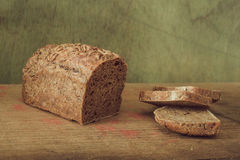 Still life- rye bread on a wooden table Royalty Free Stock Photos