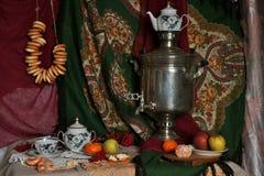 still life with a samovar, fruit stock photos
