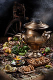 Still Life With Samovar, Fruits, Tea And Spinning Wheel Stock Image