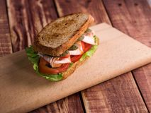 Sandwich with ham, cheese, tomatoes, lettuce, and toasted bread. stock photos