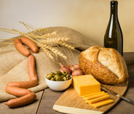 Still life with sausage cheese and bread Stock Photo