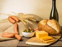 Still life with sausage cheese and bread Stock Images