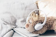 Still Life Scene, Cute toy with Headphones and keyboard. stock photography