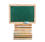 Still life with school books near blackboards on Stock Image