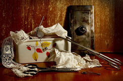 Still life with scissors, pins and laces royalty free stock image