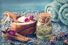 Sea salt with dry rose petals royalty free stock photography