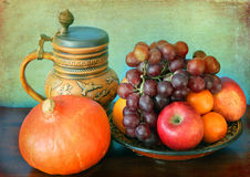 Still life: seasonal fruits and hokkaido pumpkin and a mug Royalty Free Stock Image