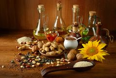 Still life seeds and oils useful for health. Flax, sesame, sunflower, olives, walnut, peanuts Stock Images