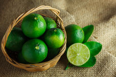 Still life selective focus to slice  fresh lime and leaf lime on Stock Photos