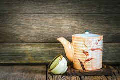 Still life of set of japanese ceramic teapot and cup on wooden t Royalty Free Stock Image