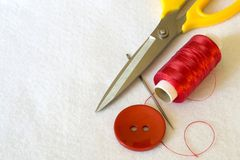 Still-life with sewing accessories on a light shag background. royalty free stock images
