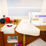 Still life with a sewing machine, embroidery, details and cloth. Royalty Free Stock Photo
