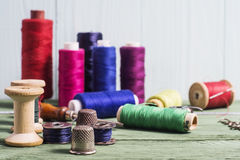 Still life of sewing, thimble, thread spools, bobbins, hooks. Stock Images